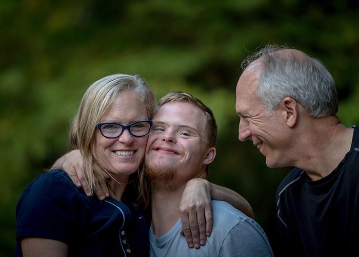 Family of three hugging