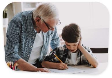 Elderly man stood with grandson