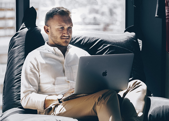 Man looking at laptop in office